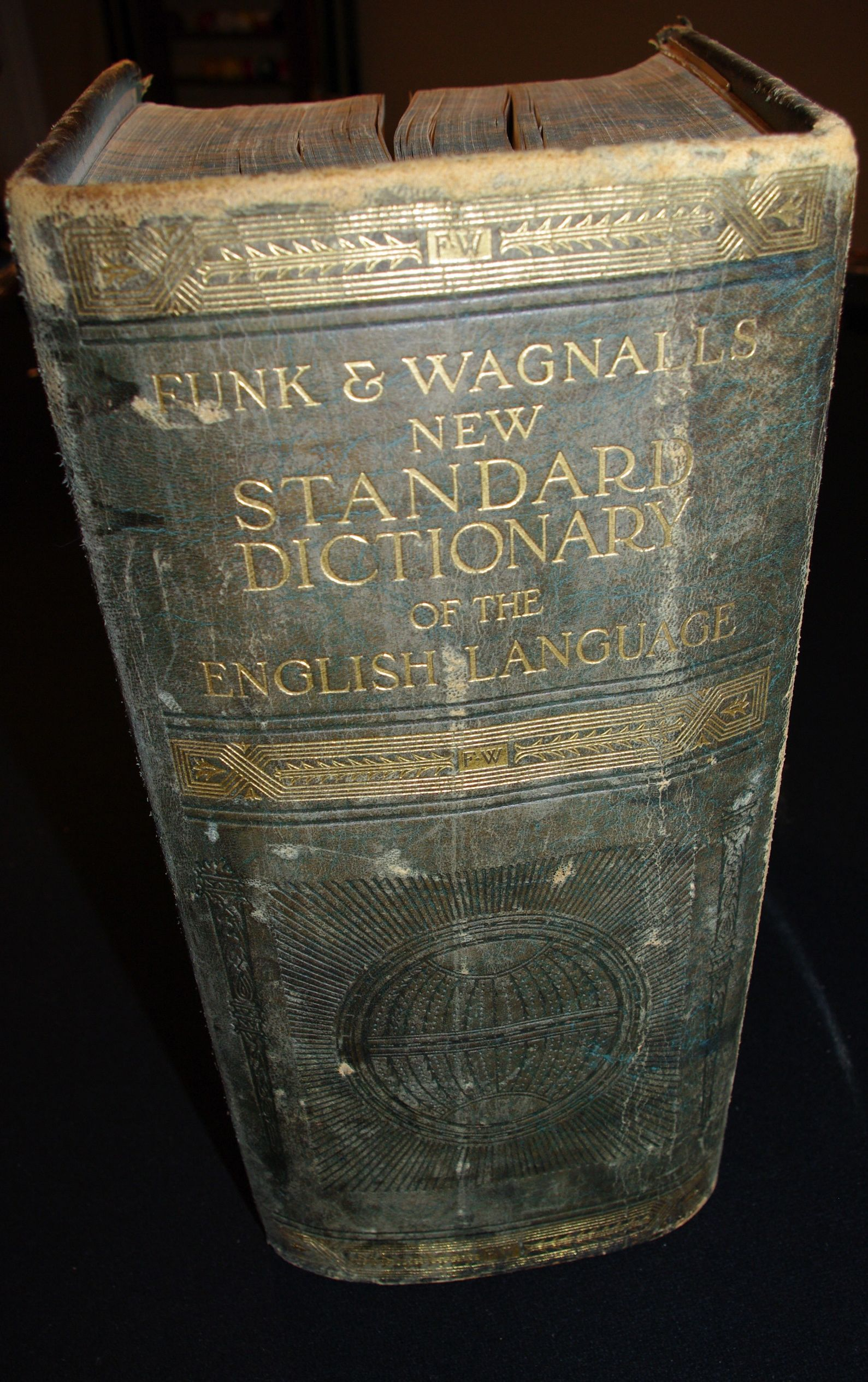 This 1924 edition Funk & Wagnalls dictionary is a great place to file odds and ends.  Photos, leaves, postcards from the past.  The problem lies in remembering my filing system.