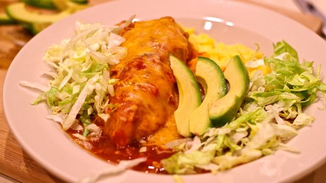 Creamy enchilada sauce, gooey cheese, tender chicken, layers of flavor. What's not to love about Green Chile Enchilada Chicken.