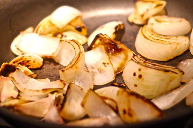 Charring the onions coaxes out their sweetness. Roast the garlic in its skin at the same time. It makes it easy to peel, and brings out its rich, buttery essence.
